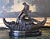 Native American Squaw in Canoe Bronze Sculpture