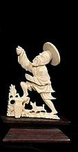 Hand carved ivory Chinese man and dog