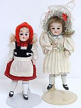 Two Bisque Girl Dolls