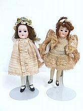 Two All Bisque 4 inch Girl Dolls