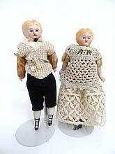 Pair of Bisque Dolls