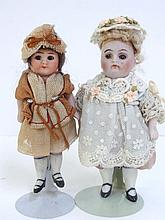 Two Germanh All Bisque Girl Dolls