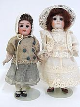 Two Bisque Swivel Head Dolls