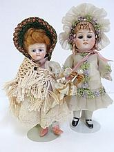 Two German All Bisque Girl Dolls