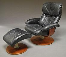 A black leather Eames style chair