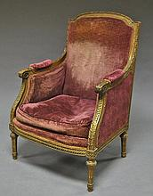 A French carved wood fauteuil