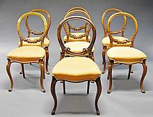 Seven Victorian walnut balloon back chairs