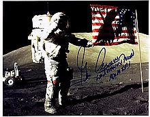 GENE CERNAN SIGNED LUNAR SURFACE PHOTO.