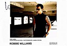 A ROBBIE WILLIAMS PHOTOCOPIED SIGNATURE ON AN ORIGINAL PROMO PHOTO