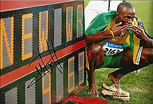 USIAN BOLT SIGNED PHOTO.