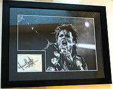 MICHAEL JACKSON SIGNED INDEX CARD WITH 16X12 INCH BLACK AND WHITE PHOTO FROM HIS BAD TOUR.