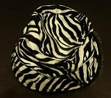 MARILYN MONROE OWNED BLACK AND WHITE STRIPED DRESS HAT.