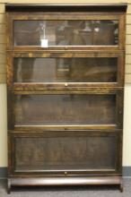 EARLY 20TH CENTURY FOUR SECTION BOOKCASE
