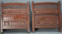 PAIR OF VICTORIAN CARVED CHERRY BEDS