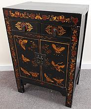 Sweet little 2 over 2 lacquered oriental cabinet