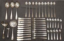 Partial set of Yu Chang sterling flatware service
