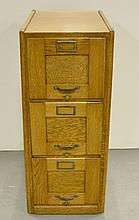 Oak three drawer file cabinet