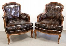 Pair of leather  bergere chairs