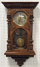 Walnut cased regulator clock