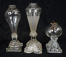 Three glass whale oil lamps