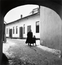 VISHNIAC, ROMAN (1897-1990) Father taking his son to the first day of cheder, Mukacevo.