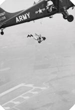 (WOLRD WAR II--FLIGHT) Album with 44 photographs apparently made by a WWII military skydiver,