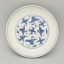 A blue and white Saucer Dish, Ming Dynasty, Jiajing (1522-1566), painted in underglaze blue with four flying cranes amongst clouds, the underside similarly decorated, four character mark: wan fu you tong (may infinite good fortune surround you),