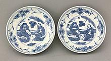 A pair of small Saucer Dishes, Ming dynasty, late 16th/early 17th century, each painted in underglaze blue with bearded figures in a garden, the sides with bamboo and the underside with fruiting vine, four character mark: wan fu you tong (may