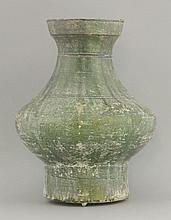 A green lead-glazed Vase,  AFCHan dynasty (206 BCE - 220 CE), heavily potted with pronounced belly and strong neck and two incised bands, all under a crazed iridescent green glaze, degradation, 35cm