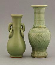 A Longquan celadon Vase, AFCYuan dynasty (1279-1368), of elongated pear form, the neck with loop and fixed ring handles, under a soft grey-green glaze, R&G; McPherson paper label,15.5cm, andanother Longquan celadon Vase, Yuan dynasty (1279-1368), the