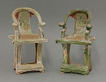 A pair of earthenware Tomb Chairs, AFC Ming dynasty (1368-1644), with horseshoe frame and incised peony, the seat with a yellow-glazed rush incising and with general lead-green glaze, much degradation, 21.5cm (2)Literature: See 'Catalogue of Late