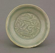 A good and unusual Qingbai moulded small Dish,  AFCSouthern Song dynasty (1127-1279), with two fish swimming amongst lotus within beaded and key fret borders, all under an even blue-green glaze, the rim unglazed, 10.5cm