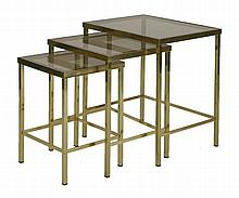 A nest of three tubular brass tables,  with smoke glass tops,  55.5cm wide  46cm deep