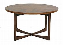 A rosewood circular coffee table,  1960s, the veneered top raised on a 'X' form stand,  84cm