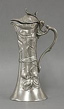 A WMF Art Nouveau pewter ewer and lid,  moulded with orchids on a tapering body,  23cm high