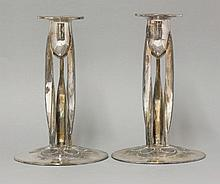 A pair of plated Tudric candlesticks,  designed by Archibald Knox for Liberty & Co., stamped 'En