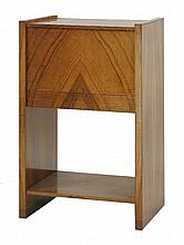 A walnut work cabinet,  the hinged top enclosing a well and tray, over a single drawer and shelf