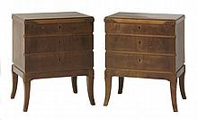 A pair of walnut bedside chests,  with three drawers with carved details and on splayed legs,