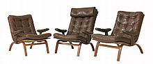 A pair of Swedish bentwood armchairs,  with chocolate button backs, seats and arms, one with a h
