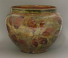 A Royal Doulton stoneware 'Foliage Ware' jardiniŠre,   of compressed baluster form, impresssed m