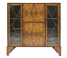 An Art Deco walnut and coromandel bureau display cabinet,  the central hinged writing surface wi