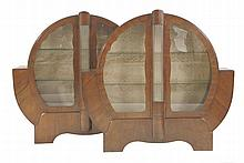 A pair of Art Deco walnut display cabinets,  each of circular form, the central columns with gla