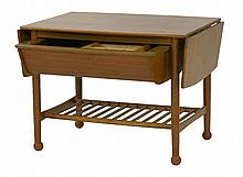 A teak drop-leaf coffee table,  with a trough below, fitted with a sliding tray, over a slatted