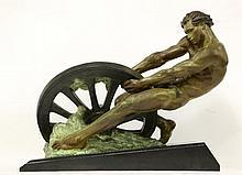 An Art Deco bronzed spelter figure,   by A Margelin, depicting a muscular man pulling a broken c
