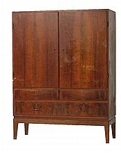 A Danish walnut cupboard,  enclosing shelves, over two short and one long drawer,  112cm wid