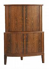 A Danish rosewood corner cabinet,  1960s, with a series of shelving, panelled sides and on block