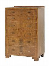 A walnut chest of six graduated drawers,  with brass loop handles, on stepped block feet,  7