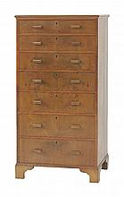 A walnut chest of seven graduated drawers,  each drawer with a lock, raised on bracket feet,