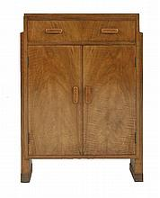 An Art Deco walnut side cabinet,  with a single drawer over a cupboard,  62cm wide  31cm