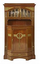 A Secessionist mahogany wall cabinet,   the moulded cornice over an arched and glazed cupboard,